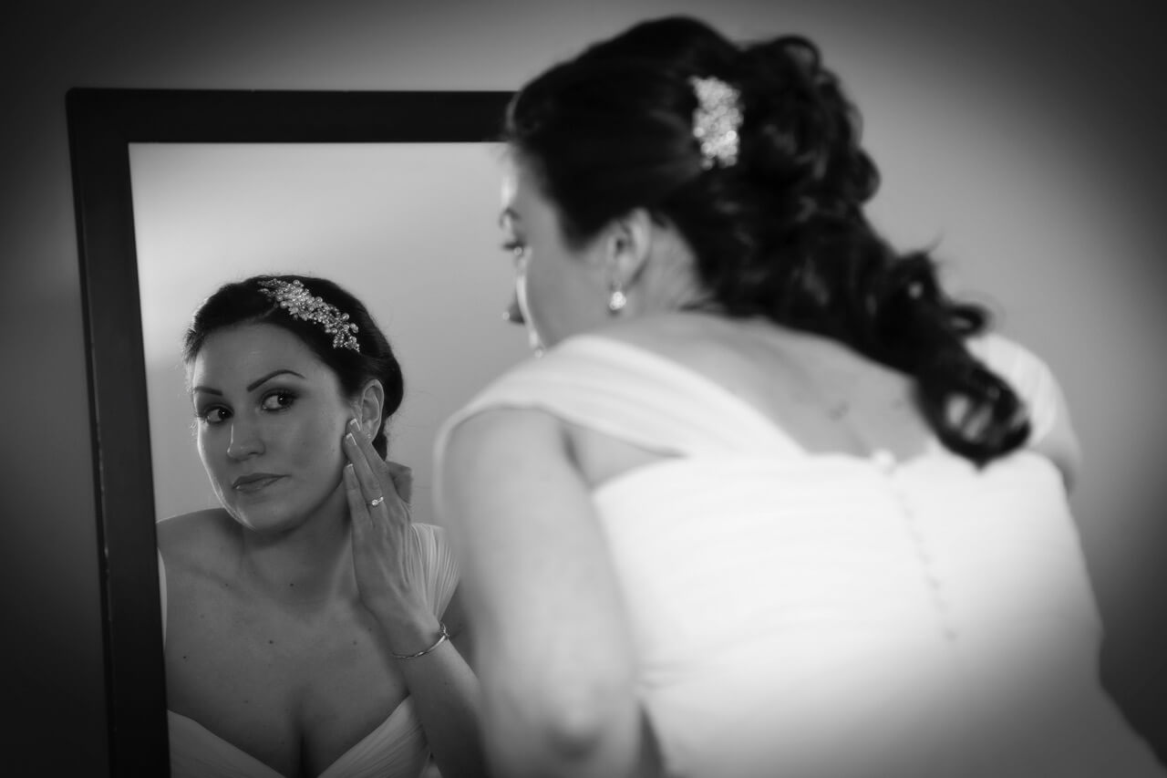 bride touching up makeup before reception Three Bells