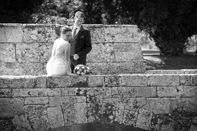 bride & groom brinsop court hereford on bridge overlooking water