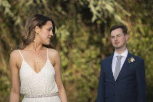 sultry evocative bride looking over shoulder at groom