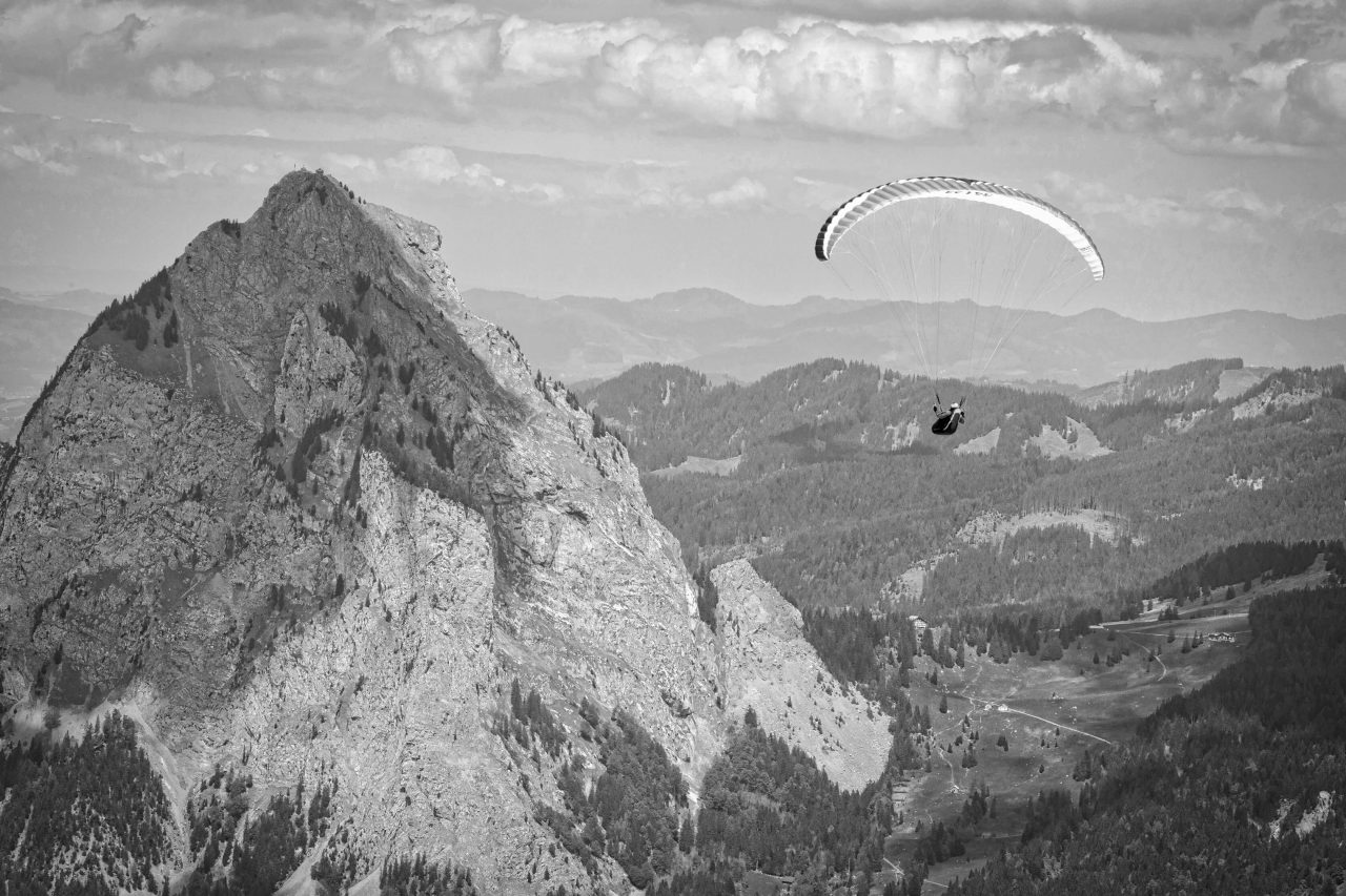Paraglider having taken off from the top of the Fronalpstock mountain, switzerland
